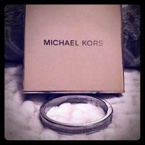 Michael Kors silver bracelet.
